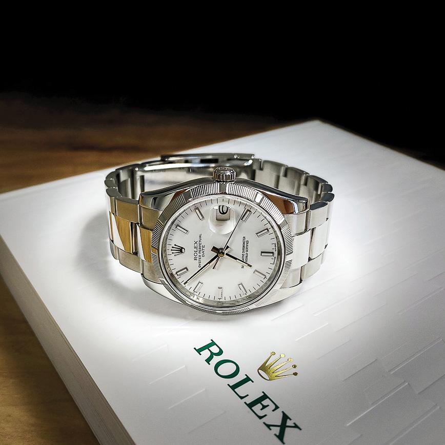 Montre Rolex Oyster date 34mm cadran blanc lunette cannelé acier, Corse, Paris