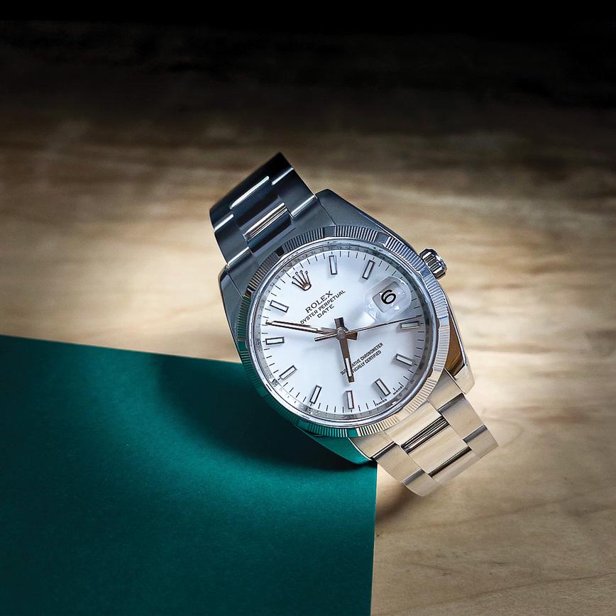 Rolex Oyster date 34mm cadran blanc lunette cannelé acier